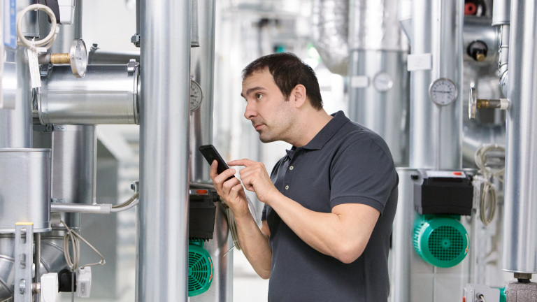 Installer Jesus working in boiler room