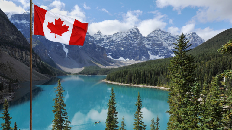 The Canadian National flag set against the Rocky Mountains of Banff National ParkCanada