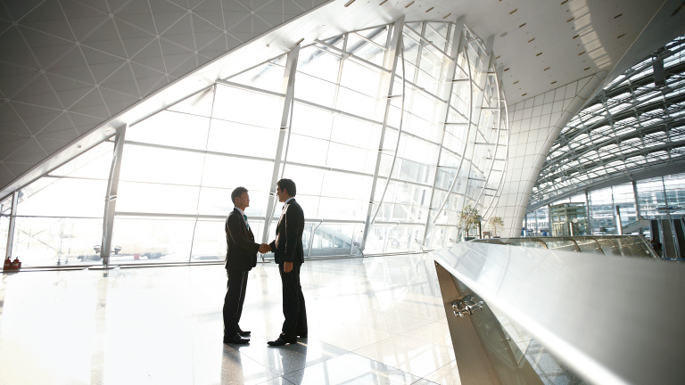 Handshake in entrance hall of the incheon international airport