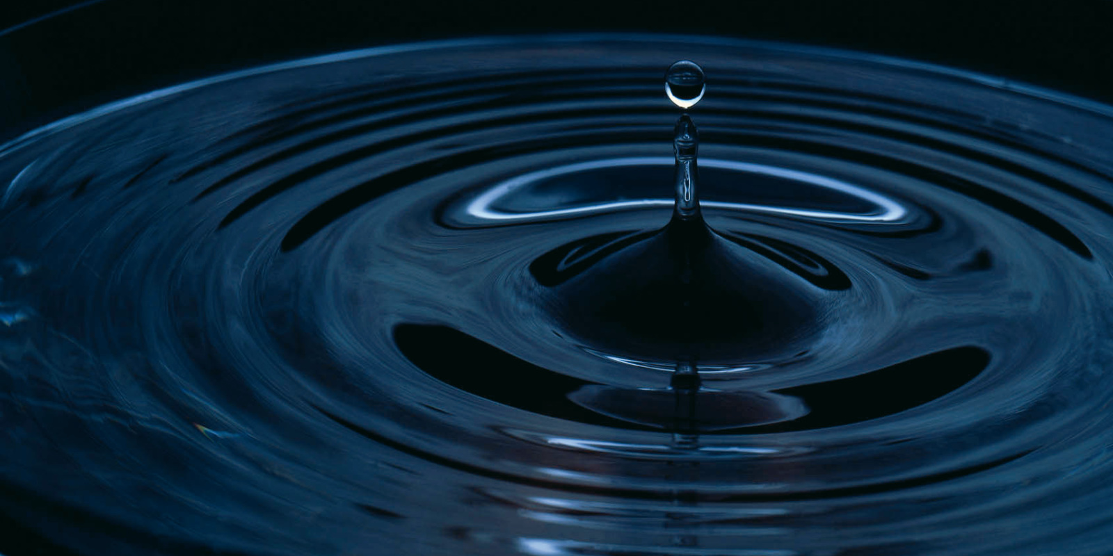 Waterdrop in dark water